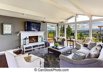 Luxury house interior. Living room with beautiful view -...