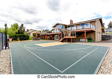 House backyard with sport court and patio area - House with...