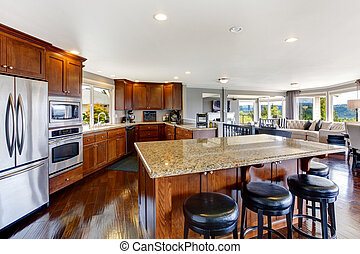 Spacious luxury kitchen room interior with kitchen island...