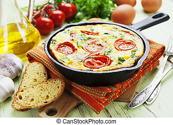 Omelet with vegetables and cheese Frittata in a frying pan