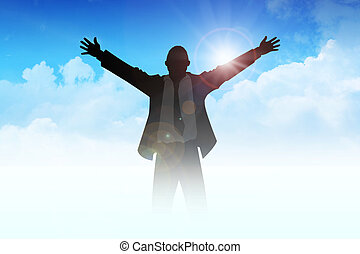Freedom - Silhouette of a man with open arms among the...
