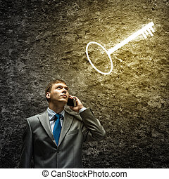 Finding solution - Young thoughtful businessman looking at...