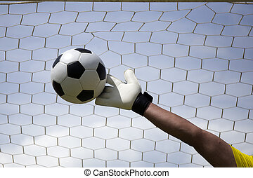 goalkeeper's hands reaching foot ball - goalkeeper's hands...