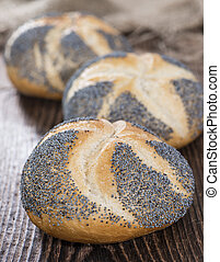 Fresh made Poppyseed Buns on dark wooden background