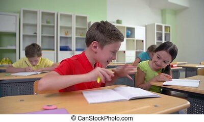 Discipline Problem - Dolly of two classmates whispering at...