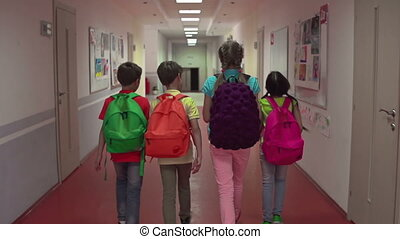 Ahead to Knowledge - Camera following four kids with...