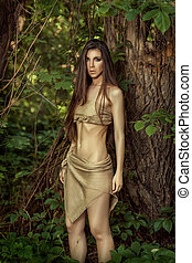 Savage girl in the woods. - Savage woman with long hair in...