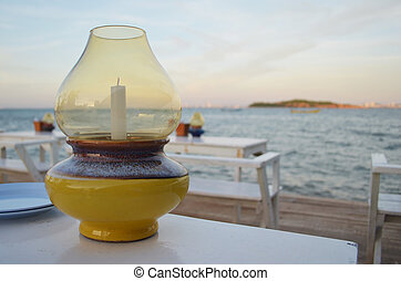 jar candle in the restaurant by the sea