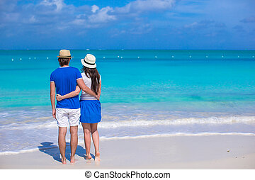 Young happy couple during their Caribbean vacation - Young...