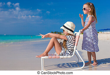 Little cute girls on white beach during vacation - Little...