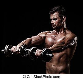 athletic young man on black background - athletic young...