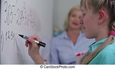 Academic Performance - Focus shifting from girl doing sums...