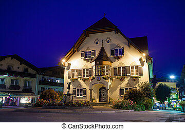 Statue of Mozart and townhall at night in St. Gilgen -...