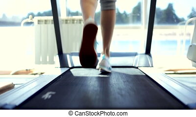 Running on a Treadmill - Woman running on a treadmill....