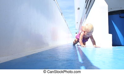 girl crawling on deck - little blond girl in purple dress...