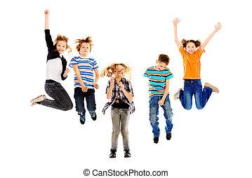 high spirits - Cheerful boys and girls jumping for joy....