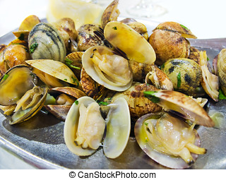 Clams mariniere style. - Clams mariniere. Typical...