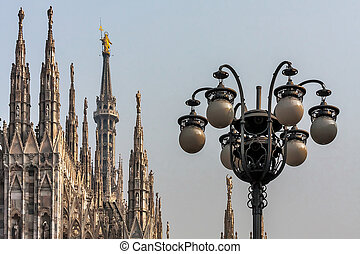 Spires of the Duomo Cathedral and street lamps in Milan