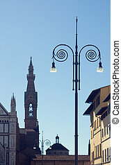 Fishnet lights and church steeple in Florence