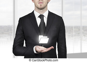 businessman holding folder symbol in open hand - businessman...