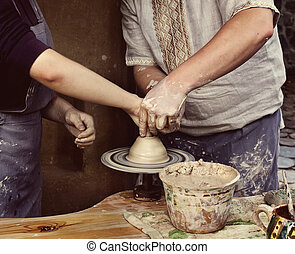The master class of pottery art - Woman creating a bowl on a...