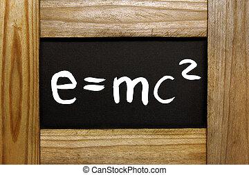wooden frame with handwritten e=mc2