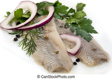 Matjes Herring - Marinated herring with onion and herbs on a...
