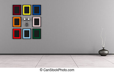 Minimalist room with colorful frame and candle on gray wall...