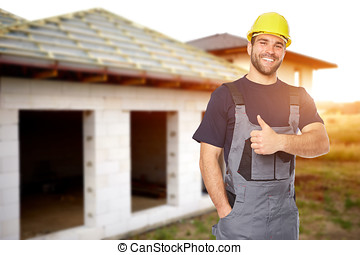 Young smiling builder gesture with his thumb up. Toned -...