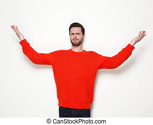 Young man gesturing with arms raised