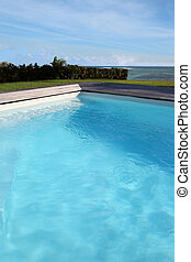 Closeup of private swimming-pool by the sea