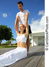 Woman with personal trainer exercising outside