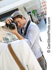 Photographer taking picture of woman model