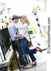 Young in love couple embracing each other in town