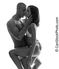 Couple passionately holding each other close - Sexy couple...