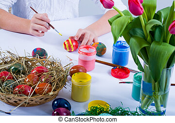 Painting Easter Eggs - the girl painting easter eggs