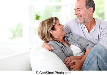 Cheerful senior couple enjoying being at home