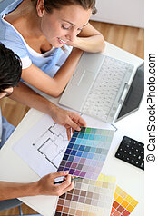 Upper view of couple looking at colour chart