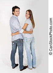 Couple with arms around each other's waist