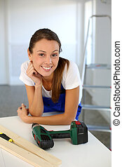 Smiling woman ready to redo home