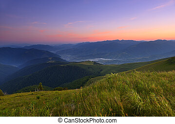 Landscape - Sunrise in the mountains in summer at the meadow