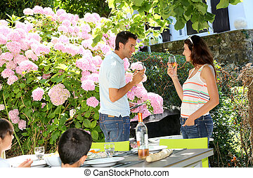 Parents cheering with wine on barbecue day