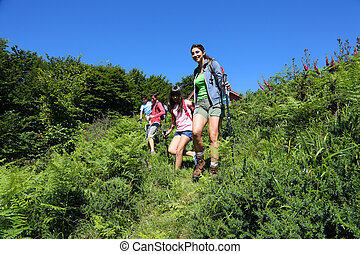 Family on a hiking day going down hill