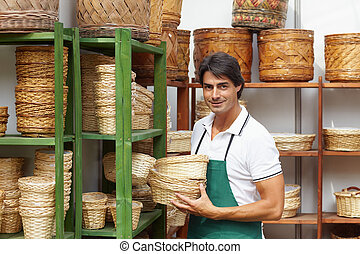 florist - portrait of male florist arranging flowerpots on...