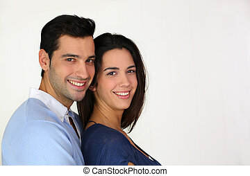 Young in love couple standing on white background