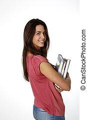 Student girl holding piles pf books