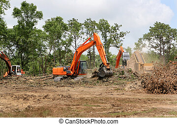 Backhoes Clearing Land - Backhoes operate clearing trees and...