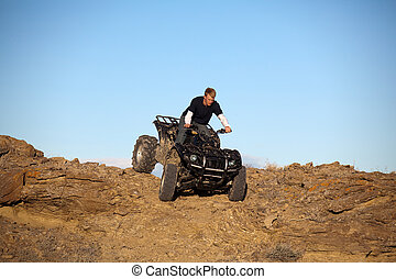 teen on ATV quad in the hills - teen on ATV quad - four...