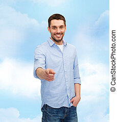 smiling man pointing finger at you