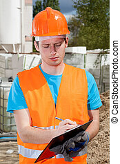 Engineer during building inspection - Engineer in orange...